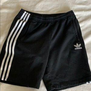 Adida shorts with white stripes.